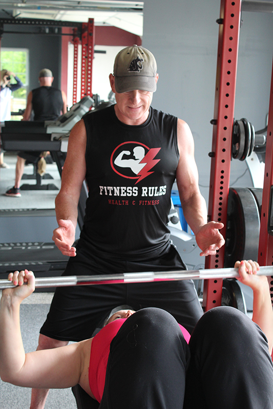 Mike Rule working with client at the Fitness Rules gym.
